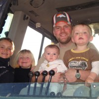 Josh and kids in backhoe